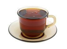 Glass cup of hot tea on plate Stock Image