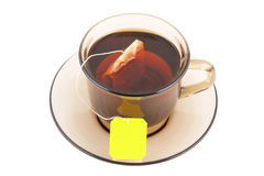 Glass cup of hot tea with tea bag Stock Photos