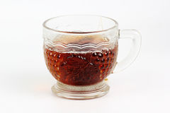 Glass cup of hot tea Stock Images