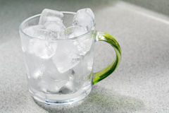 Glass cup with ice cubes Royalty Free Stock Photos