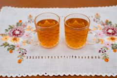 Glass cup of ice tea from tea on napkin Stock Photo