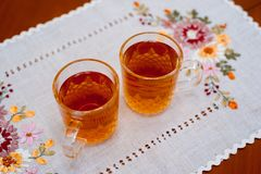 Glass cup of ice tea from tea on napkin Stock Images