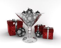 Glass cup with New Year decorative balls. With red presents on white background Royalty Free Illustration