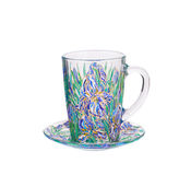 Glass cup with painted floral ornament. Royalty Free Stock Images