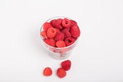 Glass Cup of Red Raspberries with Three on Counter Royalty Free Stock Images