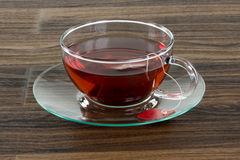 Glass cup of red tea on a wooden table Stock Photography