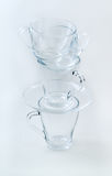 Glass cup's tower. On white background Stock Images