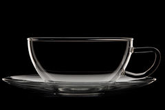 Glass cup and saucer Stock Images