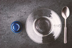 Glass cup with spoon and coffee capsule top view Royalty Free Stock Photography