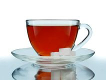 Glass Cup of Tea. With Sugar Cubes Isolated on White Stock Image