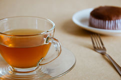 Glass Cup of Tea and Chocolate Cake. Glass cup of hot tea and chocolate cake for tea break Stock Photography