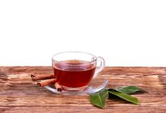 Glass cup of  tea with cinnamon sticks isolated on white. Glass cup of tea with cinnamon sticks isolated on white royalty free stock photo