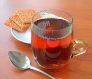 Glass cup of tea & cookies Royalty Free Stock Images