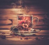 Glass cup with tea flower Royalty Free Stock Photos