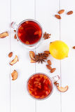 Glass cup of tea with hibiscus and lemon, cinnamon Royalty Free Stock Image