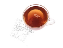 Glass cup of tea on house plan Stock Photography