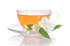 Glass cup of tea with jasmine. On the white background Stock Photos