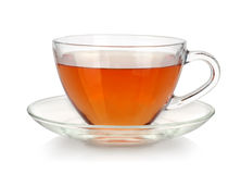 Glass cup of tea. And saucer on white background royalty free stock photos