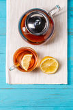 Glass cup of tea with lemon and glass teapot. Stock Photo