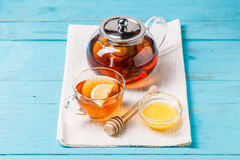 Glass cup of tea with lemon, glass teapot and honey. Stock Images