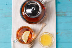 Glass cup of tea with lemon, glass teapot and honey. Stock Photography