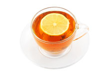 Glass cup of tea with lemon isolated Royalty Free Stock Photos