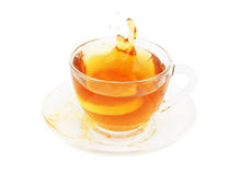 Glass cup of tea with lemon isolated Stock Images