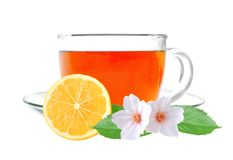 Glass cup tea with lemon and jasmine flowers Royalty Free Stock Image