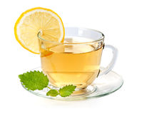 Glass cup of tea with lemon and leaf mint Royalty Free Stock Image