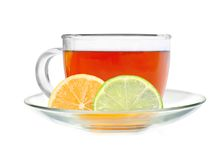 Glass cup tea with lemon and lime slices Stock Photos
