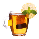 Glass cup of tea with lemon and mint isolated on white backgroun. Glass cup of tea with lemon and mint isolated on white Royalty Free Stock Image