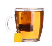 Glass cup of tea with lemon and mint isolated on white. Background Stock Photos