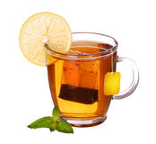 Glass cup of tea with lemon and mint isolated on white. Background Royalty Free Stock Photo