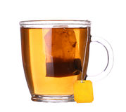 Glass cup of tea with lemon and mint on white. Glass cup of tea with lemon and mint isolated on white background Royalty Free Stock Photography