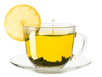 Glass cup of tea with lemon on a white background Royalty Free Stock Image