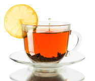 Glass cup of tea with lemon on a white background Royalty Free Stock Photos