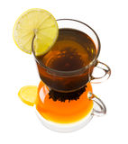 Glass cup of tea with lemon on a white background Stock Photo