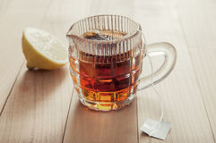 Glass cup of tea with lemon Stock Image