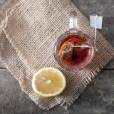 Glass cup of tea with lemon Stock Photo