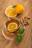Glass cup of tea with mint and lemon, almond Stock Photo