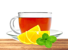 Glass cup tea, mint and lemon on table isolated on white backgro Stock Photo