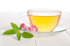 Glass cup of tea with mint and rose Stock Photography