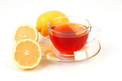 Glass cup of tea near several lemons. Royalty Free Stock Photos