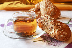 Glass cup of tea with oatmeal buns Royalty Free Stock Image