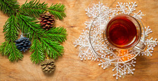 Glass Cup of tea on an old rustic table with pine branch.New yea Royalty Free Stock Image