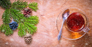 Glass Cup of tea on an old rustic table with pine branch.New yea Royalty Free Stock Photos