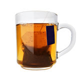 Glass cup of tea with packet Stock Photo