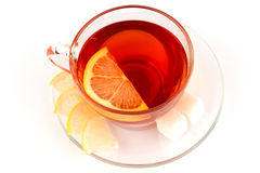Glass cup of tea with pieces of white sugar Stock Photo