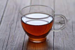 Glass cup of tea on rustic table Stock Photo
