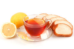 Glass cup of tea with slices white bread Stock Image